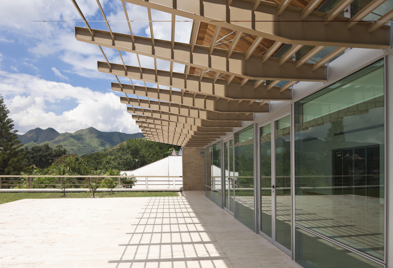 Terraza sobre fachada sur propuestas in consultas for Fachadas para terrazas de casas