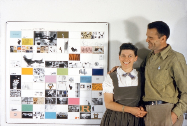 2.-the-world-of-charles-and-ray-eames.-the-couple-with-a-panel-of-work-made-for-the-american-institute-of-architects-1957.-©-eames-office-llc